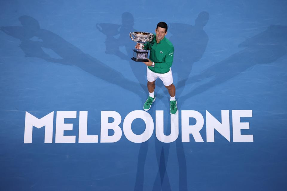 FILE PHOTO: Serbia's Novak Djokovic holds the Norman Brooks Challenge Cup trophy after winning against Austria's Dominic Thiem in their men's singles final match on day fourteen of the Australian Open tennis tournament in Melbourne on February 3, 2020.  (Photo: DAVID GRAY/AFP via Getty Images)