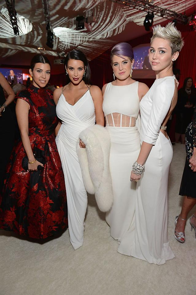 Kourtney Kardashian, Kim Kardashian, Kelly Osbourne and Miley Cyrus attend the 21st Annual Elton John AIDS Foundation Academy Awards Viewing Party at Pacific Design Center on February 24, 2013 in West Hollywood, California.