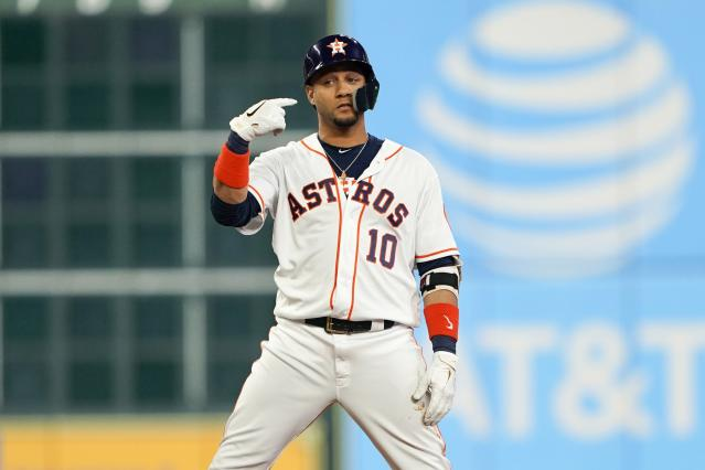 Houston Astros' Yuli Gurriel reacts after hitting a two-run scoring double during the first inning of Game 1 of the baseball World Series against the Washington Nationals Tuesday, Oct. 22, 2019, in Houston. (AP Photo/David J. Phillip)