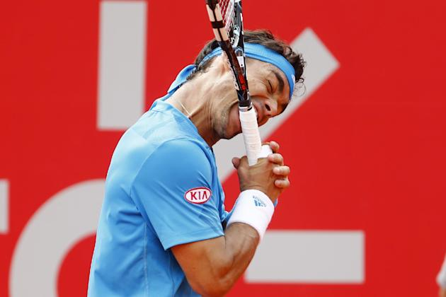 Fabio Fognini of Italy bites his racket during the Buenos Aires final in February. Things haven't improved much since. (AP Photo/Victor R. Caivano)