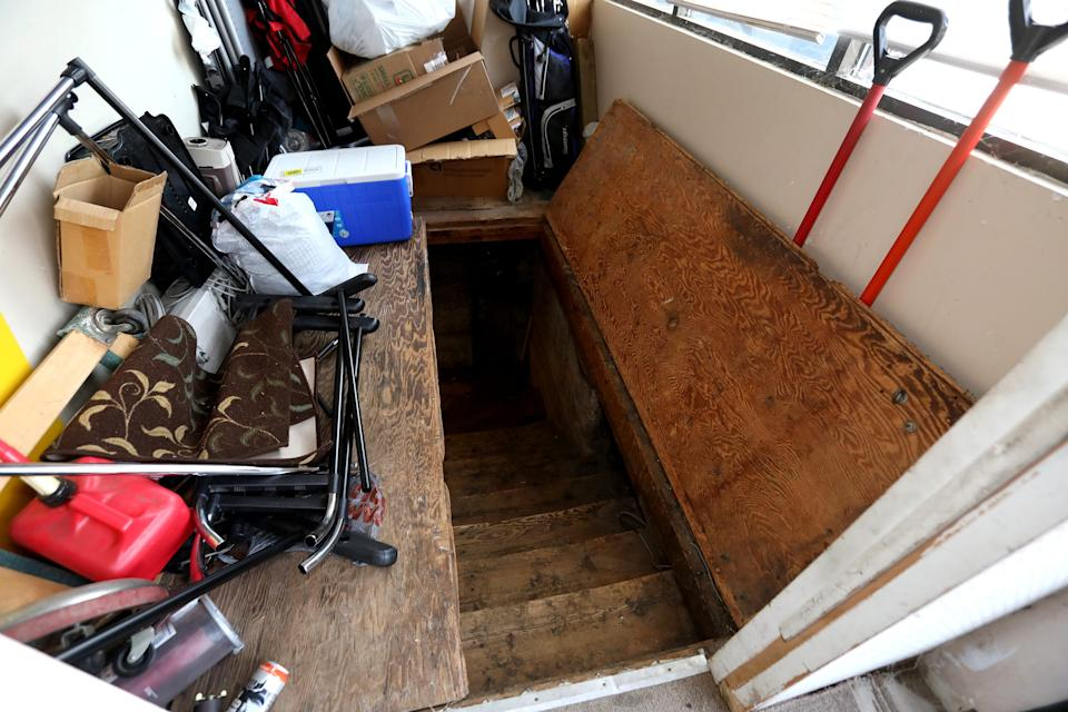 The steps that lead to the basement where Adam Fox, a suspect in the alleged kidnapping plot on Governor Gretchen Whitmer of Michigan was allowed to live temporarily. Briant Titus, 60 of Grand Rapids on Oct. 9, 2020, showed off this inside part of Vac Shack, the vacuum sales and repair shop he's owned for ten years.  Titus had known Fox since Fox was a kid and said he was just trying to do the right thing to help Fox out.