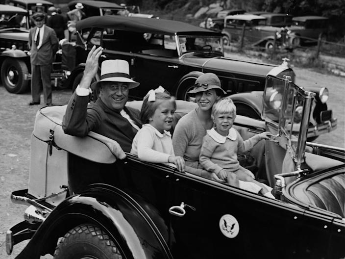 Franklin D. Roosevelt with his daughter Anna, granddaughter, Anna, and grandson, Curtis.