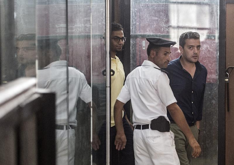 """Qatar-based Al-Jazeera denounced the verdict against the trio, who were accused of broadcasting false news, as a """"deliberate attack on press freedom"""" (AFP Photo/Khaled Desouki)"""