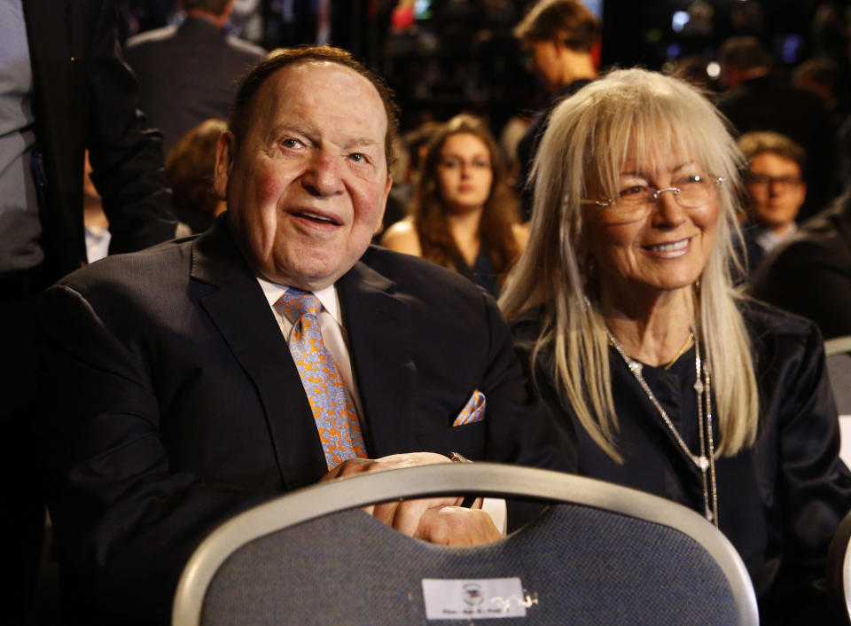 FILE - In this Sept. 26, 2016 file photo, Chief Executive of Las Vegas Sands Corporation Sheldon Adelson sits with his wife Miriam waits for the presidential debate between Democratic presidential nominee Hillary Clinton and Republican presidential nominee Donald Trump at Hofstra University in Hempstead, N.Y. Adelson, the billionaire mogul and power broker who built a casino empire spanning from Las Vegas to China and became a singular force in domestic and international politics has died after a long illness, his wife said Tuesday, Jan. 12, 2021.(AP Photo/Patrick Semansky, File)
