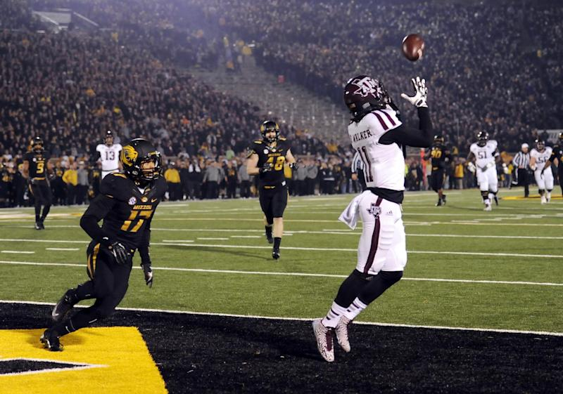 Texas A&M wide receiver Derel Walker, right, catches a 32-yard touchdown pass as Missouri safety Matt White (17) watches during the second quarter of an NCAA college football game on Saturday, Nov. 30, 2013, in Columbia, Mo. (AP Photo/L.G. Patterson)