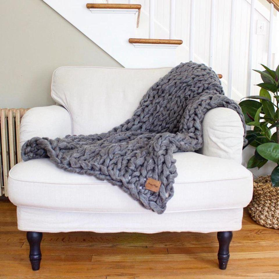 "<p>Keep mom cozy with one of these chunky knit blankets. They're easy to make by hand (er, arm, as the case may be). </p><p><em><a href=""http://www.simplymaggie.com/arm-knit-a-blanket-in-45-minutes"" rel=""nofollow noopener"" target=""_blank"" data-ylk=""slk:Get the tutorial at Simply Maggie »"" class=""link rapid-noclick-resp"">Get the tutorial at Simply Maggie »</a></em></p>"