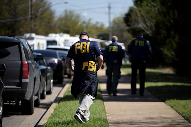 <p>FBI agents walk towards a crime scene on Mission Oaks Boulevard following an explosion in Austin, Texas, March 19, 2018. (Photo: Sergio Flores/Reuters) </p>