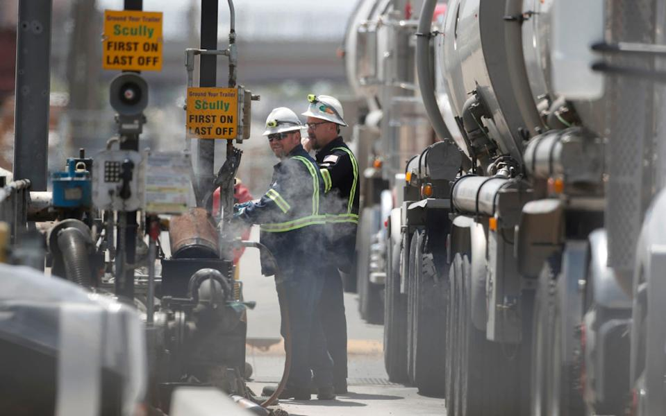 A driver empties his tanker truck of crude oil at Marathon Oil to be refined into gas on May 20, 2021 in Salt Lake City, Utah - George Frey/Getty Images North America