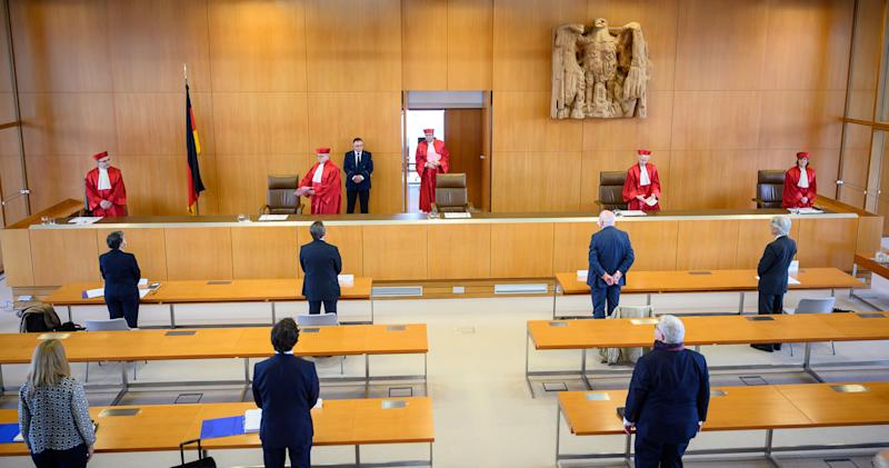 "The judges of the German constitutional court (L-R) Ulrich Maidowski, Peter M. Huber, chairman Andreas Vosskuhle, Doris König and Christine Langenfeld arrive on May 5, 2020 at the Constitutional court in Karlsruhe, togive out their ruling that the European Central Bank must clarify a key bond-buying scheme to support the eurozone economy is ""proportionate"" or else Germany's Bundesbank central bank may no longer participate. - The Bundesbank will be barred from participating in the ""quantitative easing"" (QE) asset purchase programme in three months' time ""unless the ECB Governing Council adopts a new decision that demonstrates in a comprehensible and substantiated manner that the monetary policy objectives pursued by the ECB are not disproportionate,"" the court said in a statement. (Photo by Sebastian Gollnow / dpa / AFP) (Photo by SEBASTIAN GOLLNOW/dpa/AFP via Getty Images)"