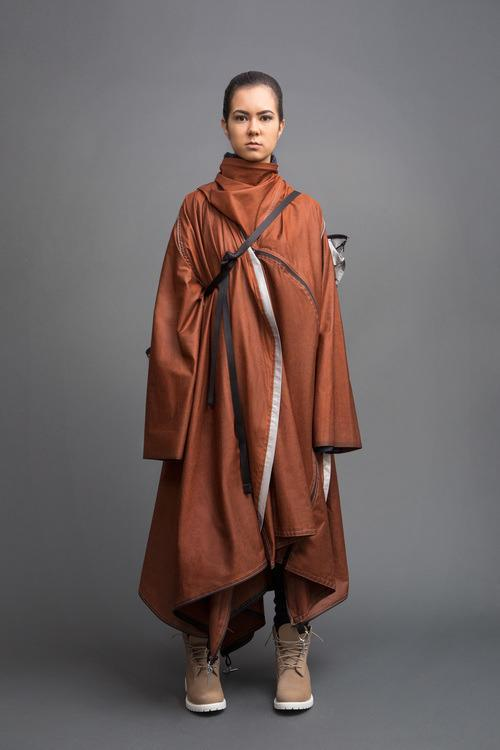 <p>It also transforms into a waterproof coat. [<i>Photo: Jessica Richmond]</i></p>