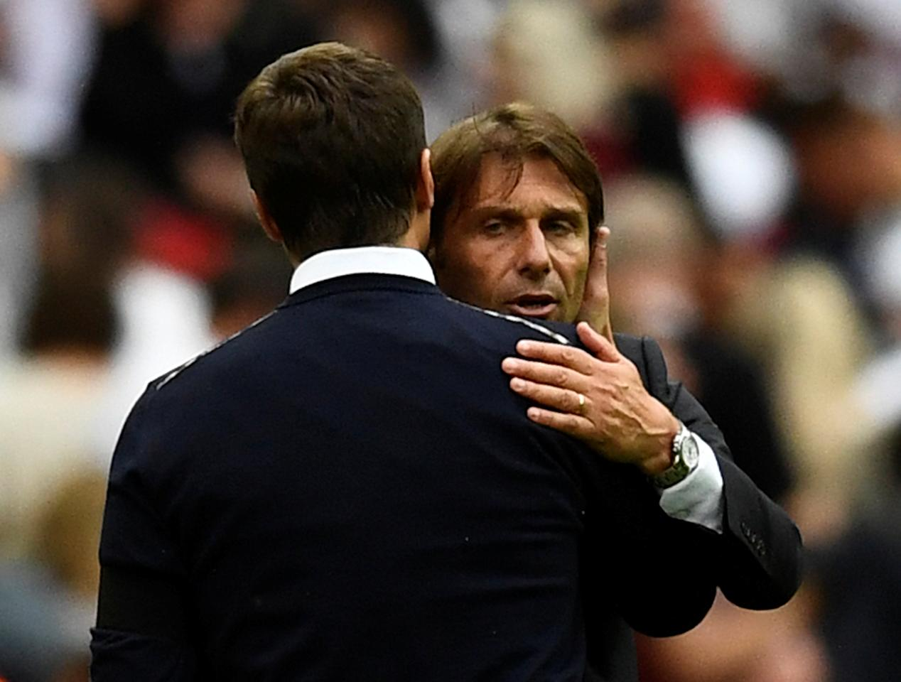 "Soccer Football - Premier League - Tottenham Hotspur vs Chelsea - London, Britain - August 20, 2017   Chelsea manager Antonio Conte and Tottenham manager Mauricio Pochettino hug after the match   REUTERS/Dylan Martinez    EDITORIAL USE ONLY. No use with unauthorized audio, video, data, fixture lists, club/league logos or ""live"" services. Online in-match use limited to 45 images, no video emulation. No use in betting, games or single club/league/player publications. Please contact your account representative for further details."