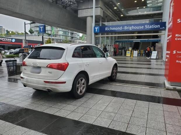 A driver who parked on a pedestrian area in front of a SkyTrain in Richmond, B.C., was dinged a hefty fine this week.  (Transit Police Enforcement Team/Twitter - image credit)