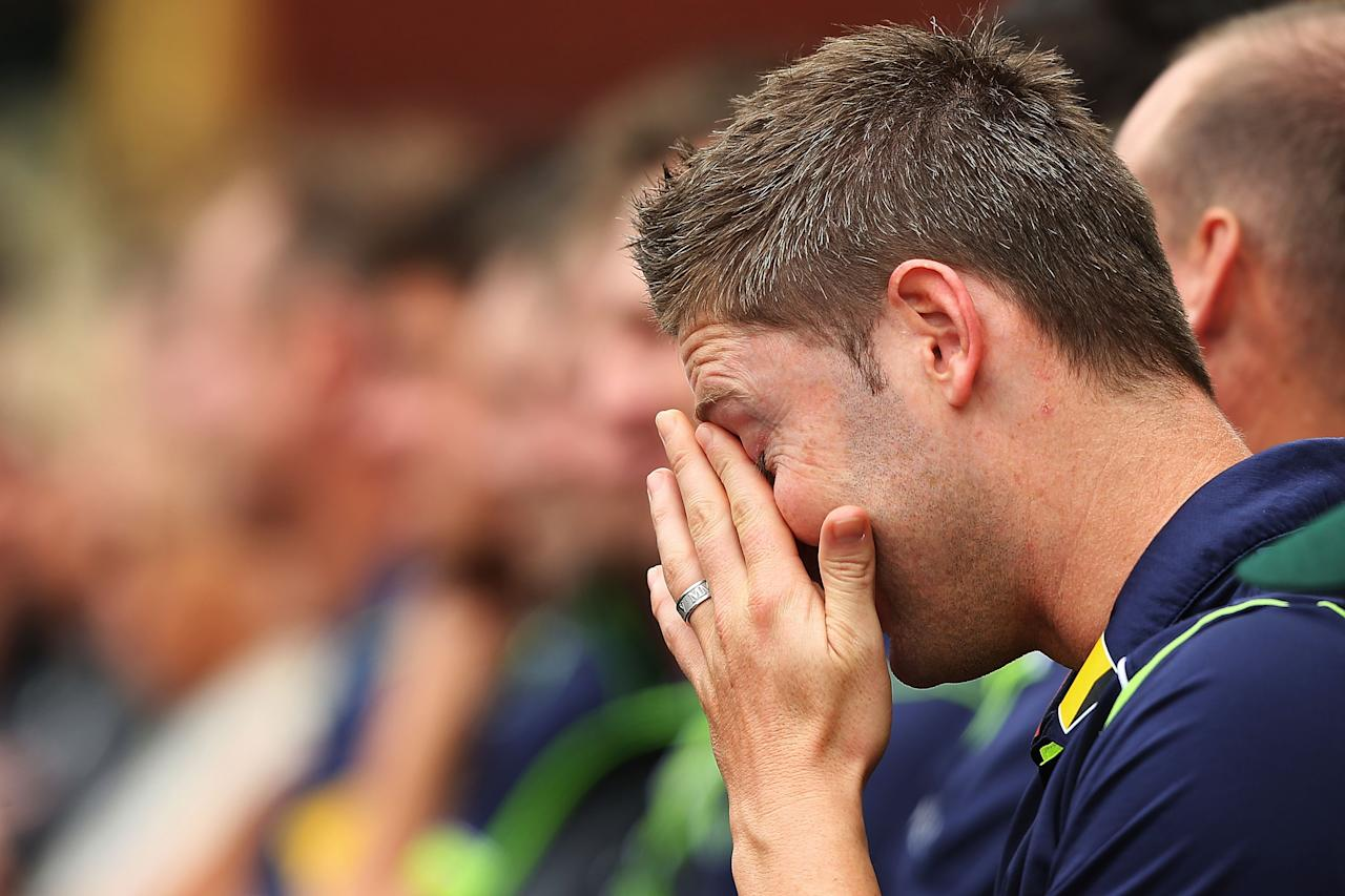 SYDNEY, AUSTRALIA - JANUARY 20: Australian cricket captain, Michael Clarke wipes away tears during the Tony Greig memorial service at Sydney Cricket Ground on January 20, 2013 in Sydney, Australia.  (Photo by Brendon Thorne/Getty Images)