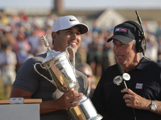 Brooks Koepka is interviewed by Curtis Strange after winning the U.S. Open Golf Championship, Sunday, June 17, 2018, in Southampton, N.Y. (AP Photo/Julio Cortez)