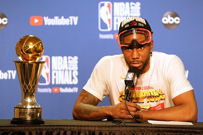 Toronto's Kawhi Leonard speaks with the news media after winning the NBA championship and being named the MVP of the Finals. (AFP Photo/Thearon W. Henderson)