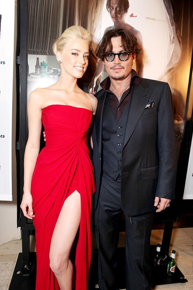 "<a href=""http://movies.yahoo.com/movie/contributor/1809059761"">Amber Heard</a> and <a href=""http://movies.yahoo.com/movie/contributor/1800019485"">Johnny Depp</a> at the Los Angeles premiere of <a href=""http://movies.yahoo.com/movie/1810077951/info"">The Rum Diary</a> on October 13, 2011."