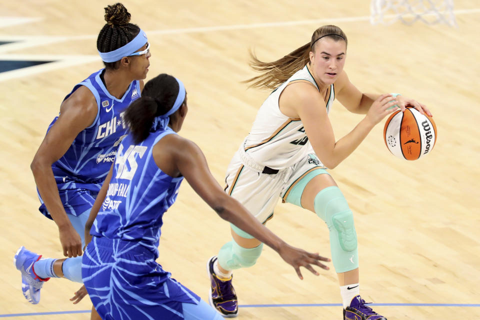 New York Liberty guard Sabrina Ionescu (20) tries to get past Chicago Sky guard Diamond DeShields, left, and center/forward Astou Ndour-Fall (45) during a their game on May 23, 2021. (AP Photo/Eileen T. Meslar)