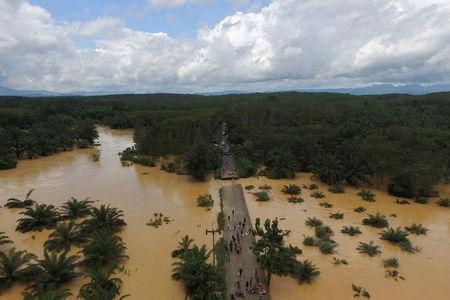 A bridge damaged by floods is pictured at Chai Buri District, Surat Thani province