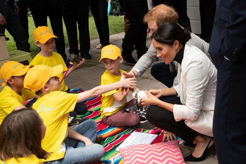 Harry and Meghan meet children from Kookaburra Kids at the Pavilion Restaurant in Sydney (PA)