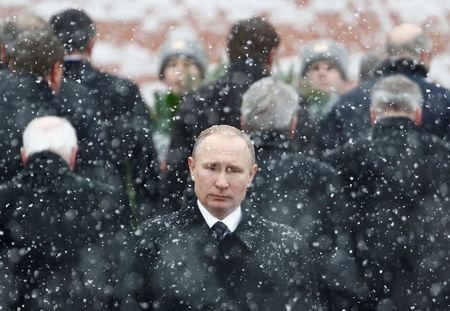 FILE PHOTO: Russian President Putin attends wreath laying ceremony to mark Defender of Fatherland Day at Tomb of Unknown Soldier by Kremlin wall in Moscow