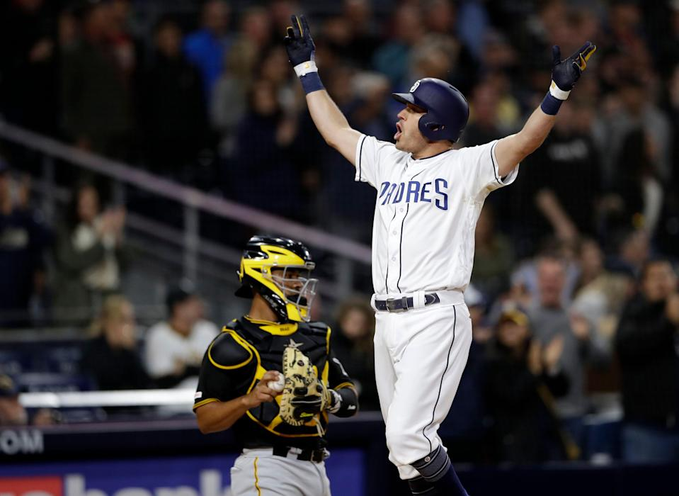 San Diego Padres' Ian Kinsler celebrates after hitting a three-run home run, next to Pittsburgh Pirates catcher Elias Diaz during the sixth inning of a baseball game Thursday, May 16, 2019, in San Diego. (AP Photo/Gregory Bull)