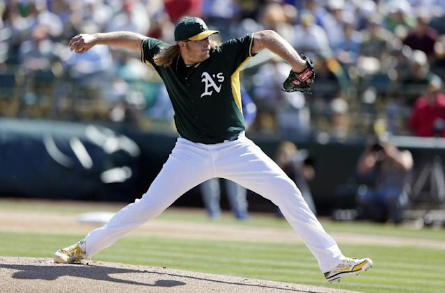 Oakland Athletics starting pitcher A.J. Griffin throws to a Los Angeles Dodgers batter during the first inning of a spring training baseball game Monday, March 3, 2014, in Phoenix. (AP Photo/Gregory Bull)