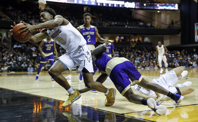 Vanderbilt guard Saben Lee (0) tries to keep the ball in bounds in the second half of an NCAA college basketball game against Alcorn State Friday, Nov. 16, 2018, in Nashville, Tenn. Vanderbilt won 79-54. (AP Photo/Mark Humphrey)