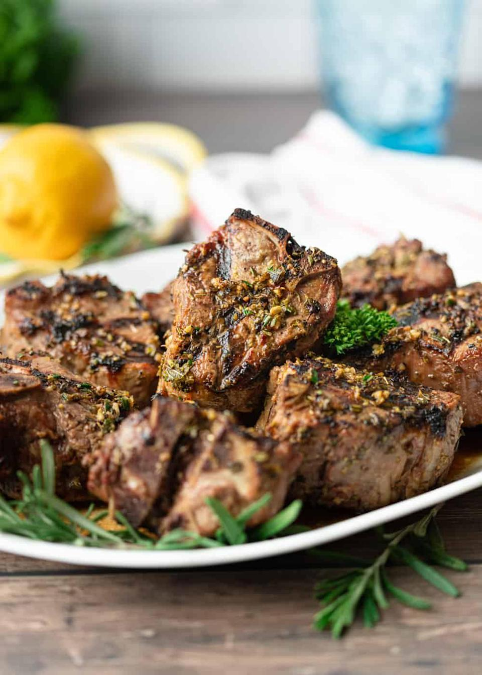 """<p>Juicy, juicy, juicy and impressive to look at, am I right? These lamb loin chops are coated in herbs and spices for a tender, delicious and easy dinner. </p><p>Get the <a href=""""https://keviniscooking.com/lemon-rosemary-grilled-lamb-loin-chops/"""" rel=""""nofollow noopener"""" target=""""_blank"""" data-ylk=""""slk:Greek Grilled Lamb Loin Chops"""" class=""""link rapid-noclick-resp"""">Greek Grilled Lamb Loin Chops</a> recipe. </p><p>Recipe from <a href=""""https://keviniscooking.com/"""" rel=""""nofollow noopener"""" target=""""_blank"""" data-ylk=""""slk:Kevin Is Cooking"""" class=""""link rapid-noclick-resp"""">Kevin Is Cooking</a>. </p>"""