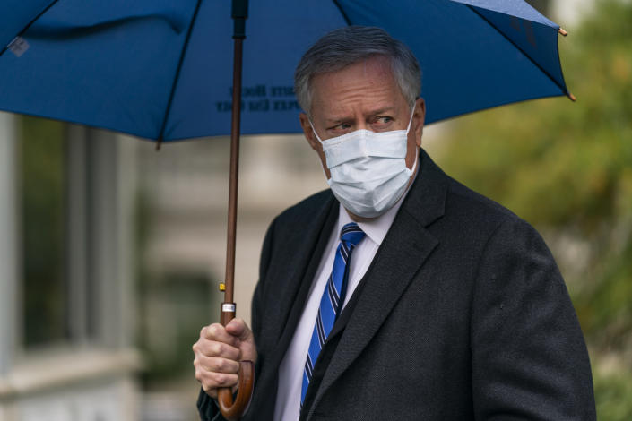 In this Oct. 25, 2020, photo, White House chief of staff Mark Meadows responds to reporters questions outside the West Wing on the North Lawn of the White House in Washington. A multi-state coronavirus surge in the countdown to Election Day has exposed a clear split between President Donald Trump's bullish embrace of a return to normalcy and urgent public warnings from the government's top health officials. (AP Photo/Manuel Balce Ceneta)