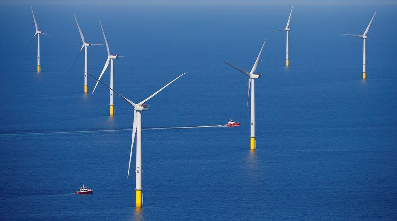 A support vessel is seen next to a wind turbine at the Walney Extension offshore wind farm operated by Orsted off the coast of Blackpool