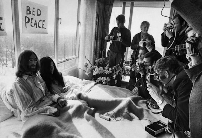 "<div class=""inline-image__caption""> <p>John Lennon and his wife Yoko Ono receive journalists on March 25, 1969, in the bedroom of the Hilton hotel in Amsterdam, during their honeymoon in Europe.</p> </div> <div class=""inline-image__credit""> AFP via Getty Images </div>"