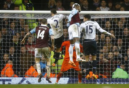 Modibo Maiga of West Ham United heads to score his team's second goal against Tottenham Hotspur during their English League Cup quarter-final soccer match at White Hart Lane, London, December 18, 2013. REUTERS/Andrew Winning