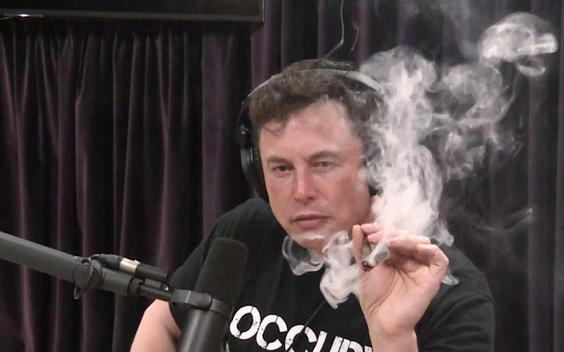 Elon Musk smoking weed live on the web during a podcast with comedian Joe Rogan.