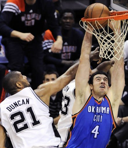 Oklahoma City Thunder power forward Nick Collison (4) dunks against San Antonio Spurs center Tim Duncan (21) during the first half of Game 5 in the NBA basketball Western Conference finals, Monday, June 4, 2012, in San Antonio. (AP Photo/Darren Abate)