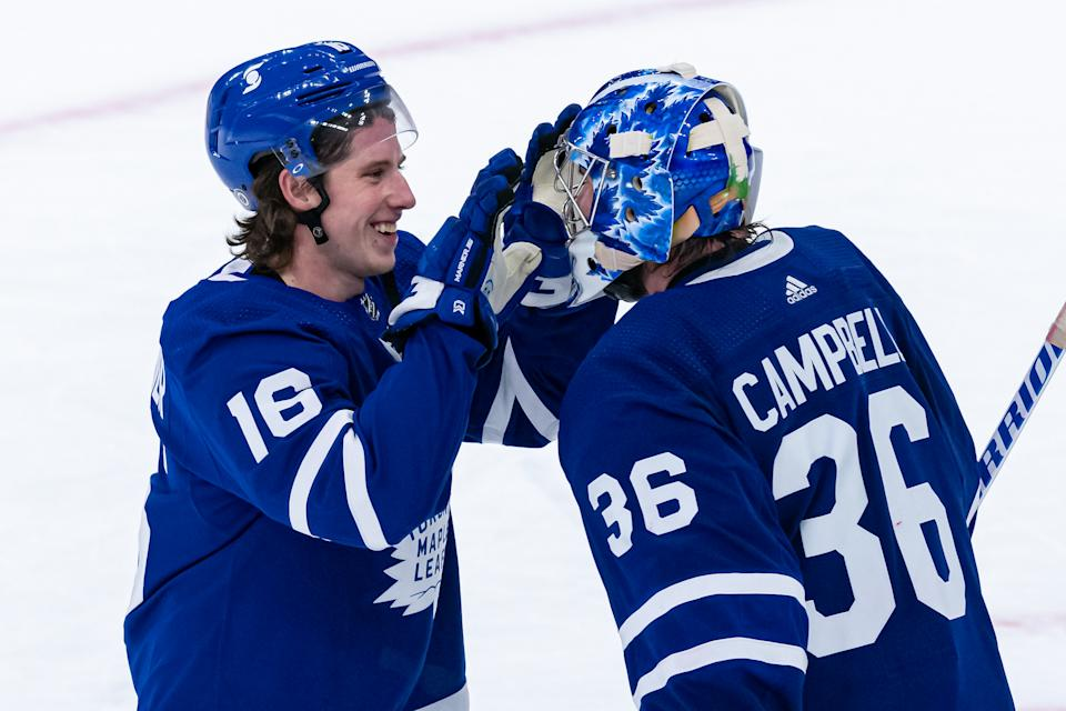 TORONTO, ON - APRIL 07: Toronto Maple Leafs Right Wing Mitchell Marner (16) congratulates Toronto Maple Leafs Goalie Jack Campbell (36) on his 10th win in a row to set a new franchise record after the NHL regular season game between the Montreal Canadiens and the Toronto Maple Leafs on April 7, 2021, at Scotiabank Arena in Toronto, ON, Canada. (Photo by Julian Avram/Icon Sportswire via Getty Images)