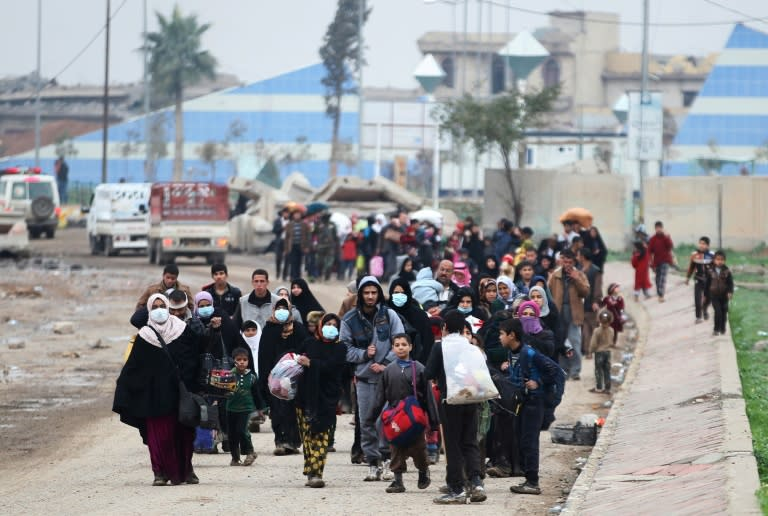 Residents of west Mosul flee the city on March 15, 2017, among more than 150,000 people who have been displaced by the offensive government forces launched against the Islamic State group last month
