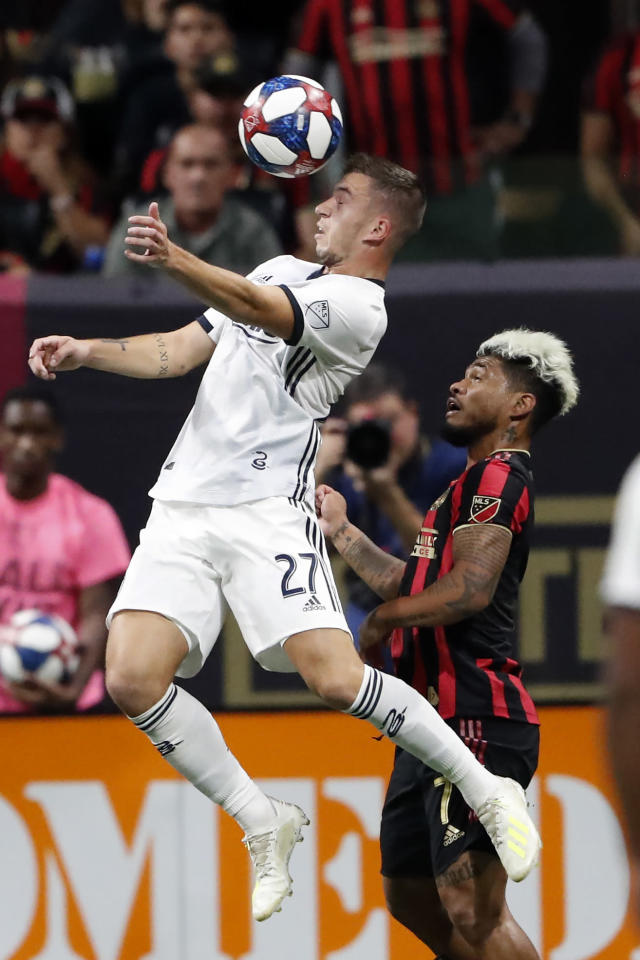 Philadelphia Union defender Kai Wagner (27) heads the ball in front of Atlanta United forward Josef Martinez (7) during the first half of an MLS soccer Eastern Conference semifinal Thursday, Oct. 24, 2019, in Atlanta. (AP Photo/John Bazemore)