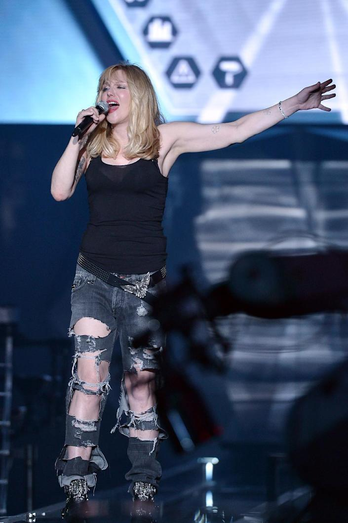 US singer Courtney Love performing before the show for fashion house Philippe Plein during the women Spring / Summer 2016 Milan's Fashion Week on September 23, 2015 in Milan