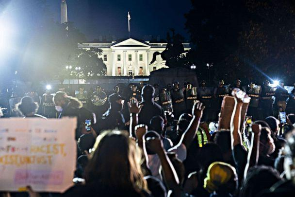 PHOTO: People gather outside the White House during a protest over the death of George Floyd, who died in police custody, in Washington, May 31, 2020. (Jim Lo Scalzo/EPA via Shutterstock)