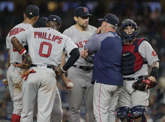Boston Red Sox starting pitcher Nathan Eovaldi talks to pitching coach Dana LeVangie during the sixth inning of the team's baseball game against the New York Yankees on Tuesday, Sept. 18, 2018, in New York. (AP Photo/Frank Franklin II)