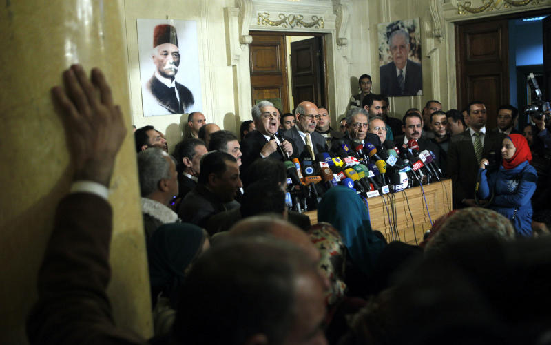 FILE - In this Monday, Jan. 28, 2013 file photo, Former Egyptian presidential candidate, Hamdeen Sabahi, center left, speaks during a press conference following the meeting of the National Salvation Front as former director of the U.N.'s nuclear agency and Nobel peace laureate, Mohamed El Baradei, center, and former Egyptian Foreign Minister and presidential candidate, Amr Moussa, center right, listen in Cairo, Egypt. Egypt's main opposition coalition announced on Tuesday it will boycott upcoming parliamentary elections, a decision likely to deepen the nation's political crisis and worsen an already troubled economy. (AP Photo/Amr Nabil, File)