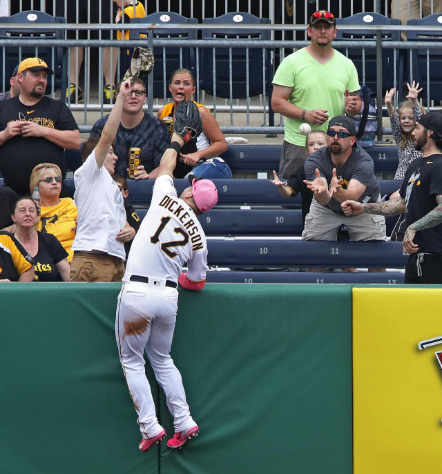 Pittsburgh Pirates left fielder Corey Dickerson (12) leaps into the stands but cannot come up with a solo home run by San Francisco Giants' Gorkys Hernandez in the sixth inning of a baseball game in Pittsburgh, Sunday, May 13, 2018. (AP Photo/Gene J. Puskar)
