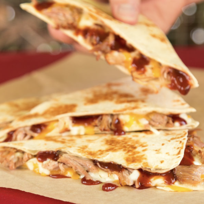 <p>Taco Bell's BBQ Pork Quesadilla checks all the right boxes. Pork carnitas? Yep. Barbecue sauce? You betcha. Three (yes, three) different cheeses melted together? Oh, yes. </p>