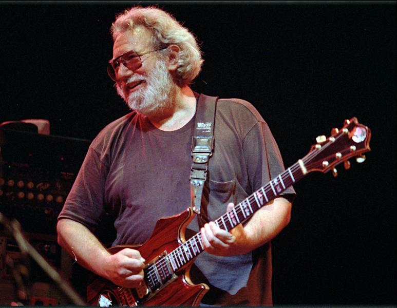 "FILE - In this Nov. 1, 1992 file photo, Grateful Dead lead singer Jerry Garcia performs at the Oakland, Calif., Coliseum. The Grateful Dead's famous 1977 Barton Hall concert is joining Donna Summer's hit ""I Feel Love"" as sounds of cultural significance, among 25 additions that are being announced Wednesday, May 23, 2012 by the Library of Congress as part of its National Recording Registry. (AP Photo/Kristy McDonald, File)"