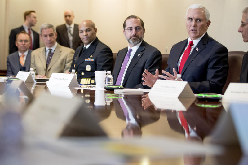 Vice President Mike Pence, accompanied by left, President Donald Trump's acting Chief of Staff Mick Mulvaney, acting Deputy Secretary of Homeland Security Ken Cuccinelli, Surgeon General Jerome Adams, Health and Human Services Secretary Alex Azar and National Institute for Allergy and Infectious Diseases Director Dr. Anthony Fauci, speaks at a coronavirus task force meeting at the Department of Health and Human Services, Thursday, Feb. 27, 2020, in Washington. (AP Photo/Andrew Harnik)