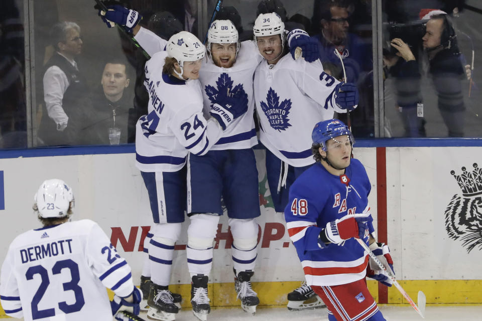 Toronto Maple Leafs' William Nylander (88) celebrates with teammates Kasperi Kapanen (24) and Auston Matthews (34) after scoring a goal as New York Rangers' Brendan Lemieux (48) reacts during the third period of an NHL hockey game Friday, Dec. 20, 2019, in New York. (AP Photo/Frank Franklin II)