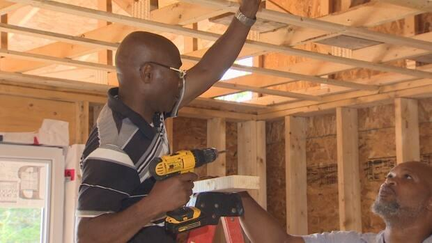Apprentice Vincent Kennedy learns on the job from Howard Benjamin. They met through the East Preston Empowerment Academy.  (Brian MacKay/CBC - image credit)