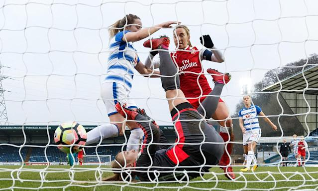 Jordan Nobbs scores the winning goal for Arsenal, beating the Reading goalkeeper Grace Moloney at Adams Park.