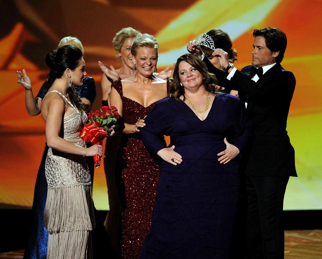 """<b>Best: Leading Ladies</b><br> On the flip side, we loved everything about the Outstanding Lead Actress in a Comedy Series award. All of the nominees walking up onstage (starting with Amy Poehler, who we at first thought was acting on her lonesome) was genius. Best of all was Melissa McCarthy taking the win and getting crowned beauty-pageant style -- not only because of how pissed we would have been if noncomic actors Laura Linney or Edie Falco had won, but because McCarthy is fabulous on """"Mike & Molly,"""" even when the writing isn't."""