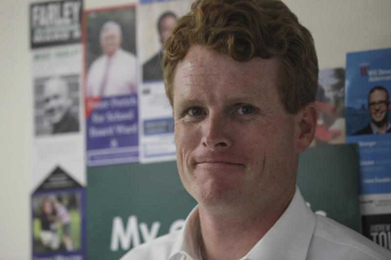 Rep. Joe Kennedy III, D-Mass., smiles at volunteers while waiting to speak about his campaign for Democratic presidential candidate Sen. Elizabeth Warren at the New Hampshire for Warren kick off field office opening in Manchester, N.H. Thursday, Sept. 5, 2019: (AP Photo/ Cheryl Senter)